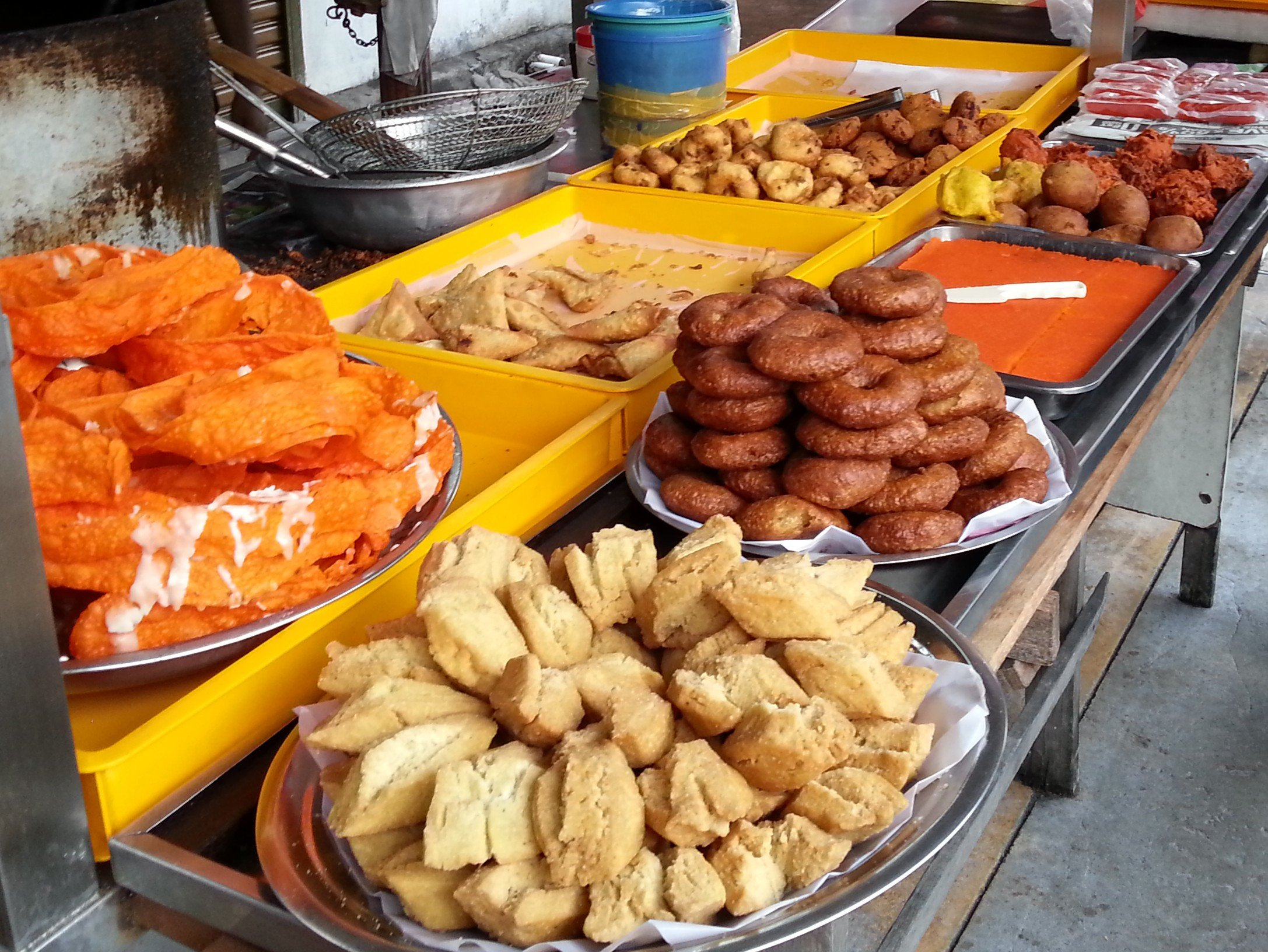 Samosa, onion bhaji and other snacks on sale in Little India